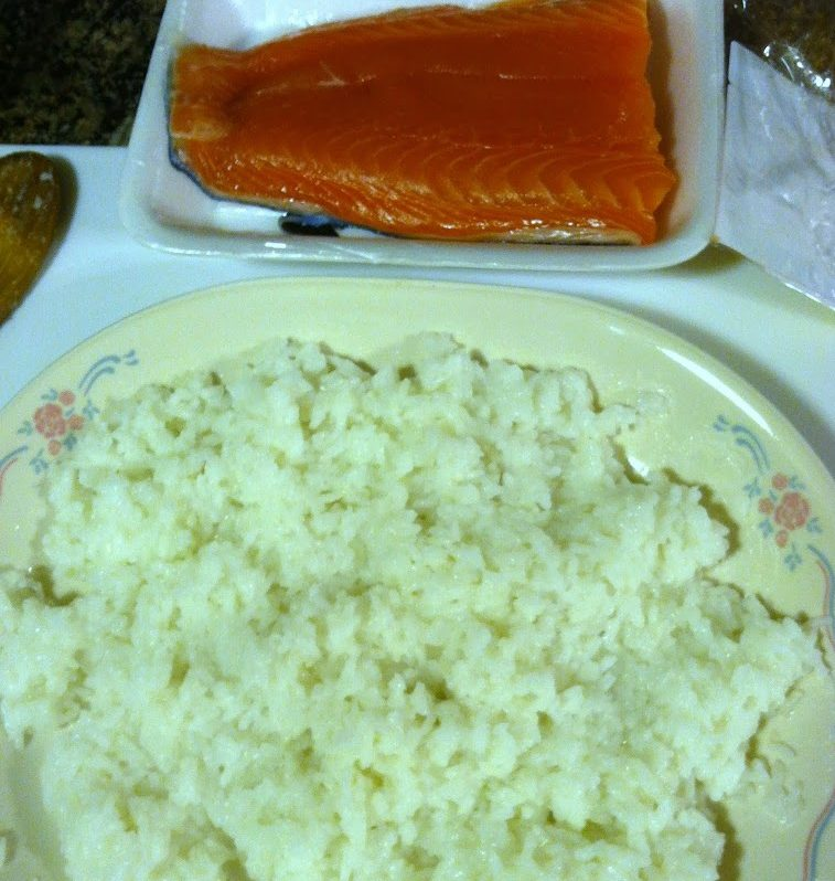 cooked white rice and salmon for nigiri