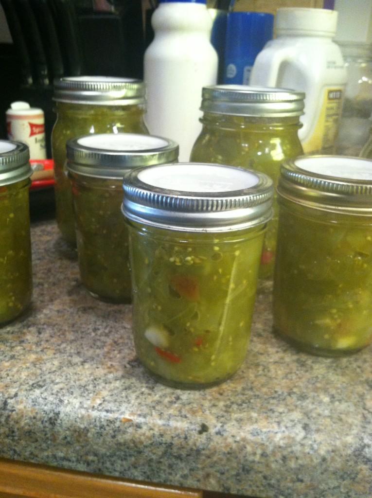 Green tomato salsa jars vertical