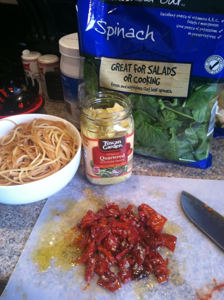 Dried tomato and artichoke pasta ingredients on counter