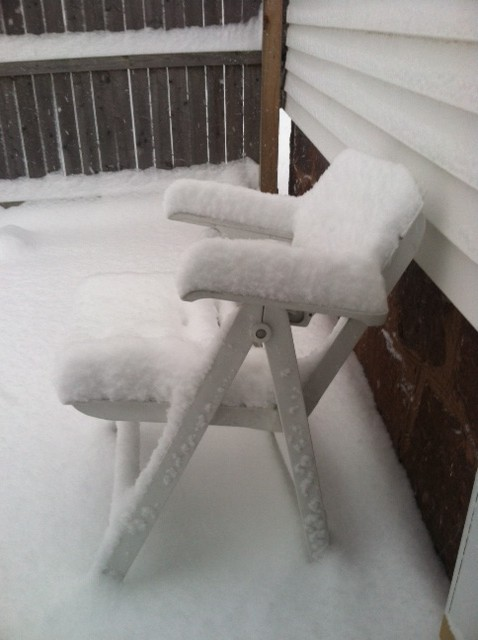 Chair covered with snow