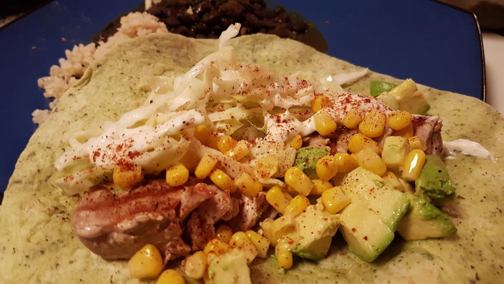 Ahi tuna taco with slaw and corn and avocado salsa