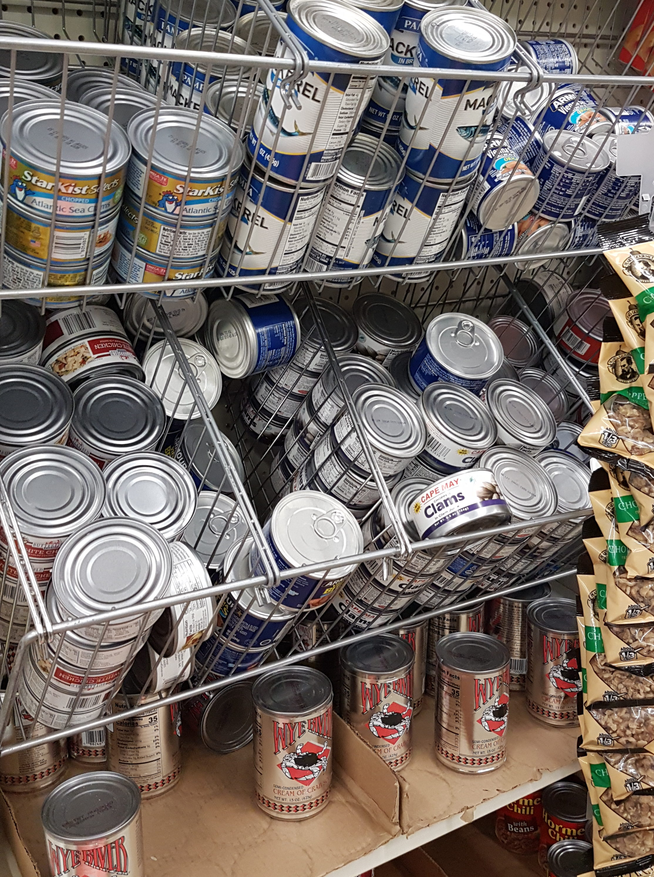Dollar Tree shelves canned tuna and meats