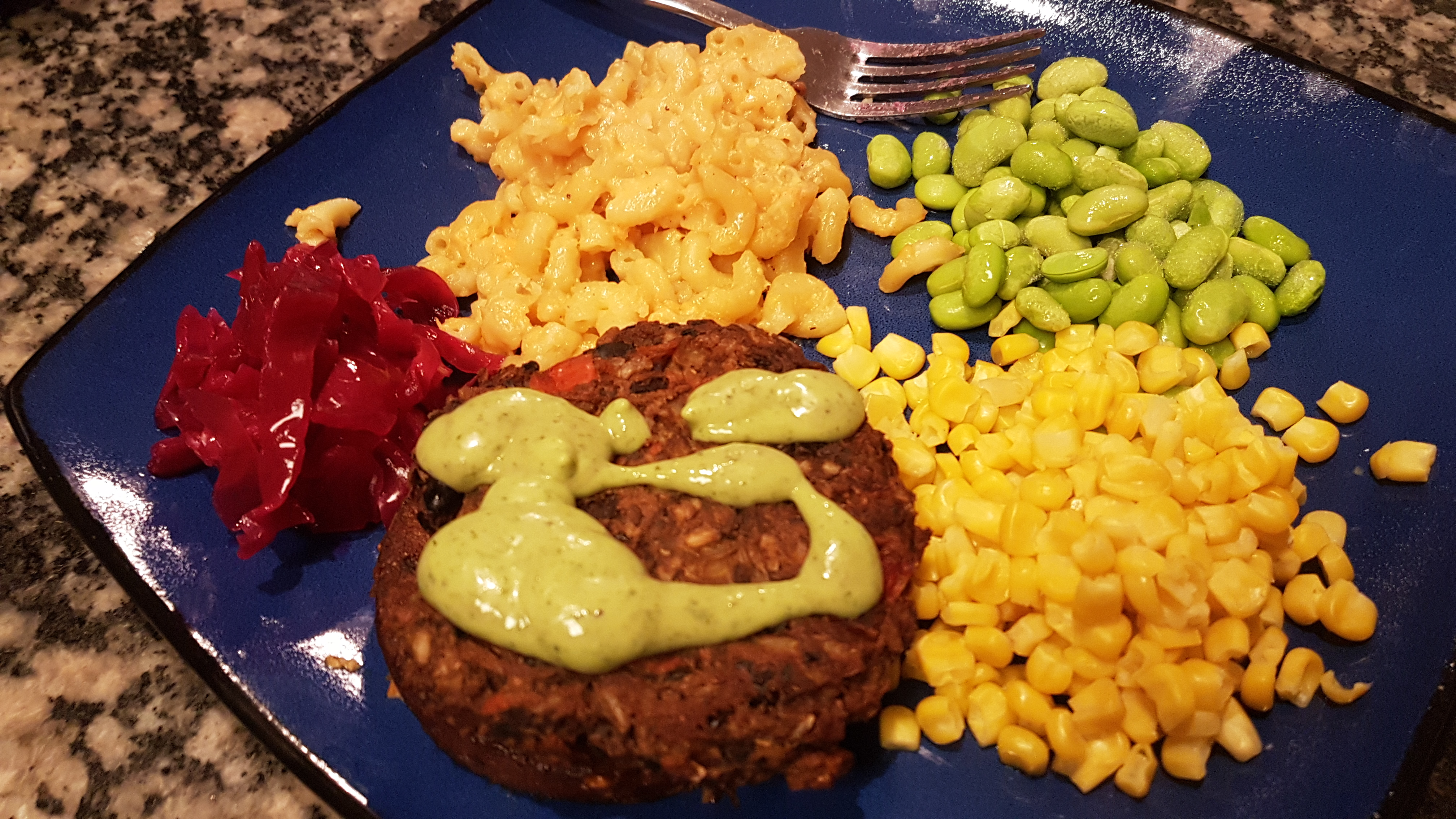 veggie burger with green goddess and mac n cheese