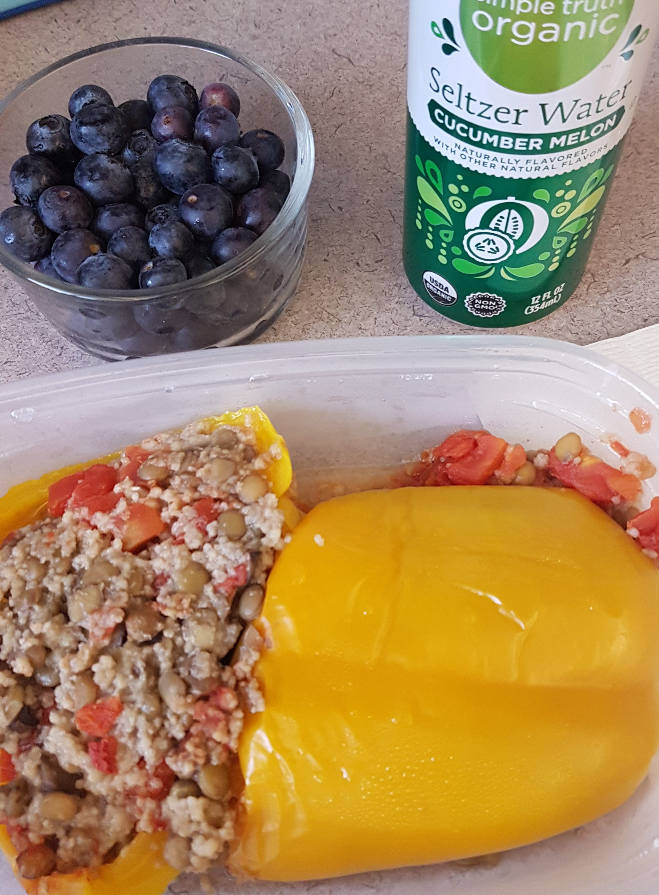 lentil and couscous stuffed pepper with blueberries