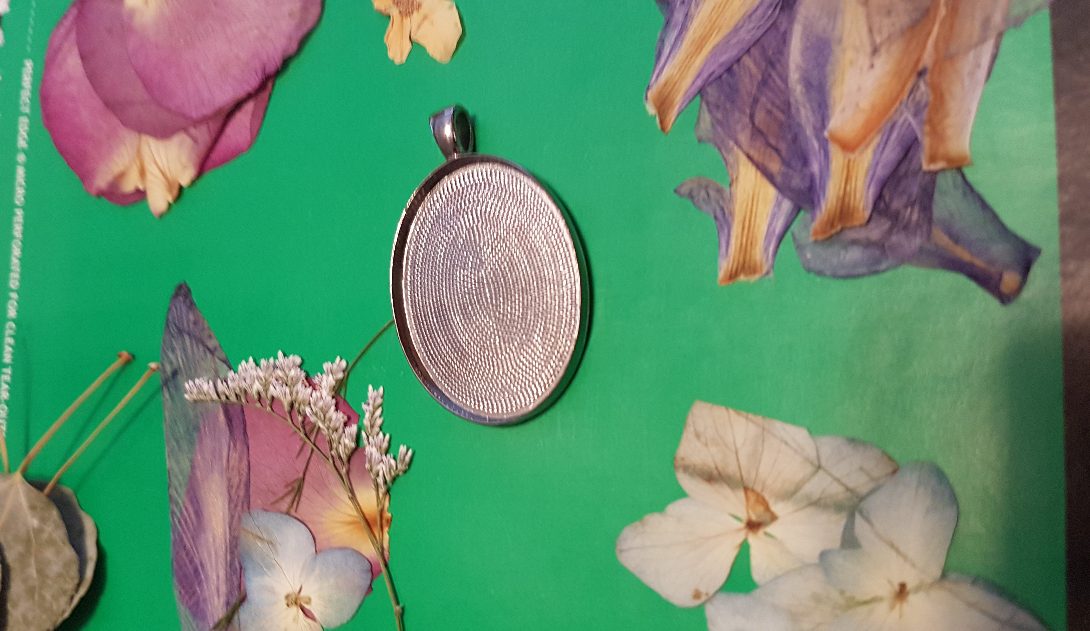 dried flowers and empty bevel to make a necklace