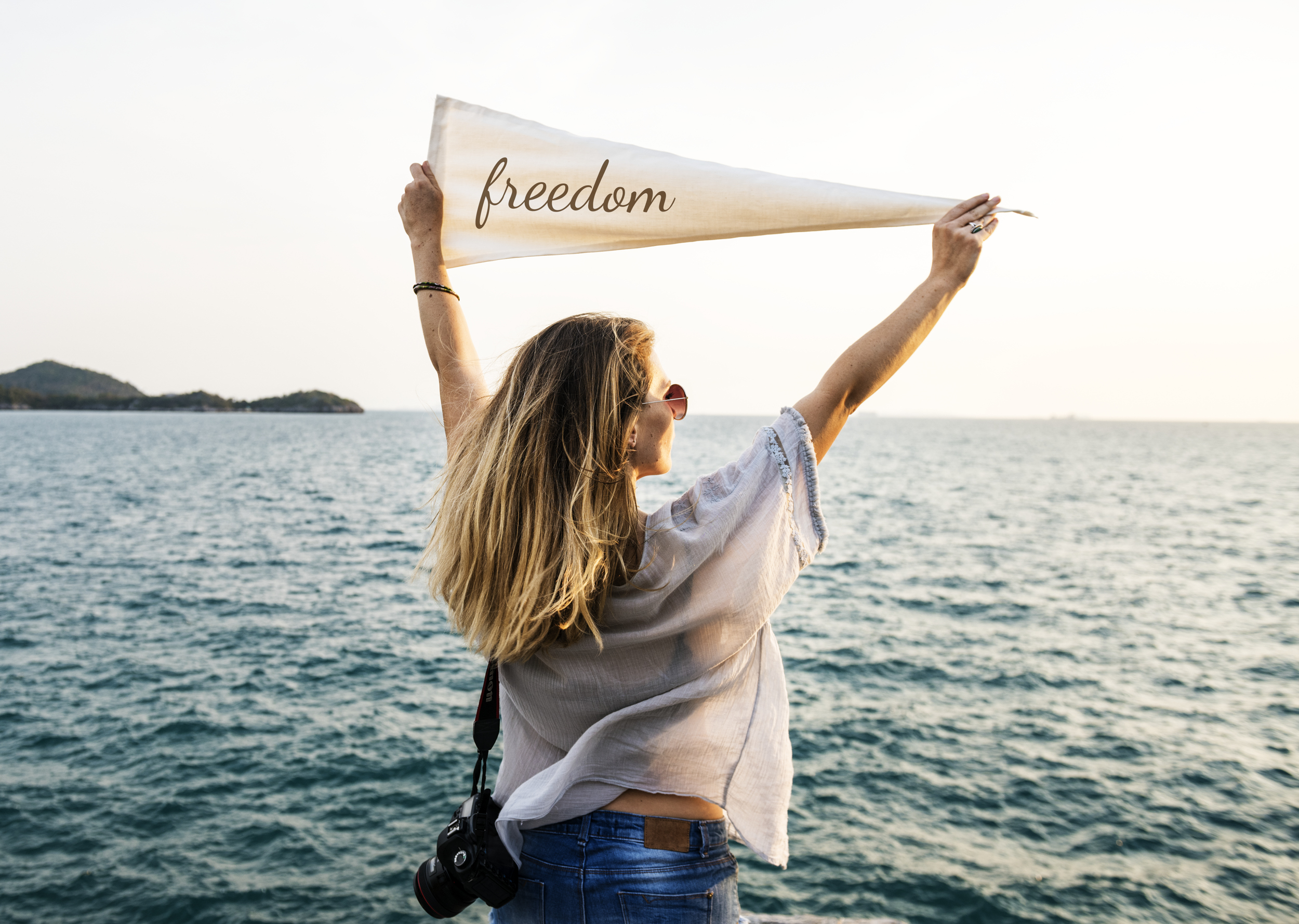 Woman holding Freedom banner