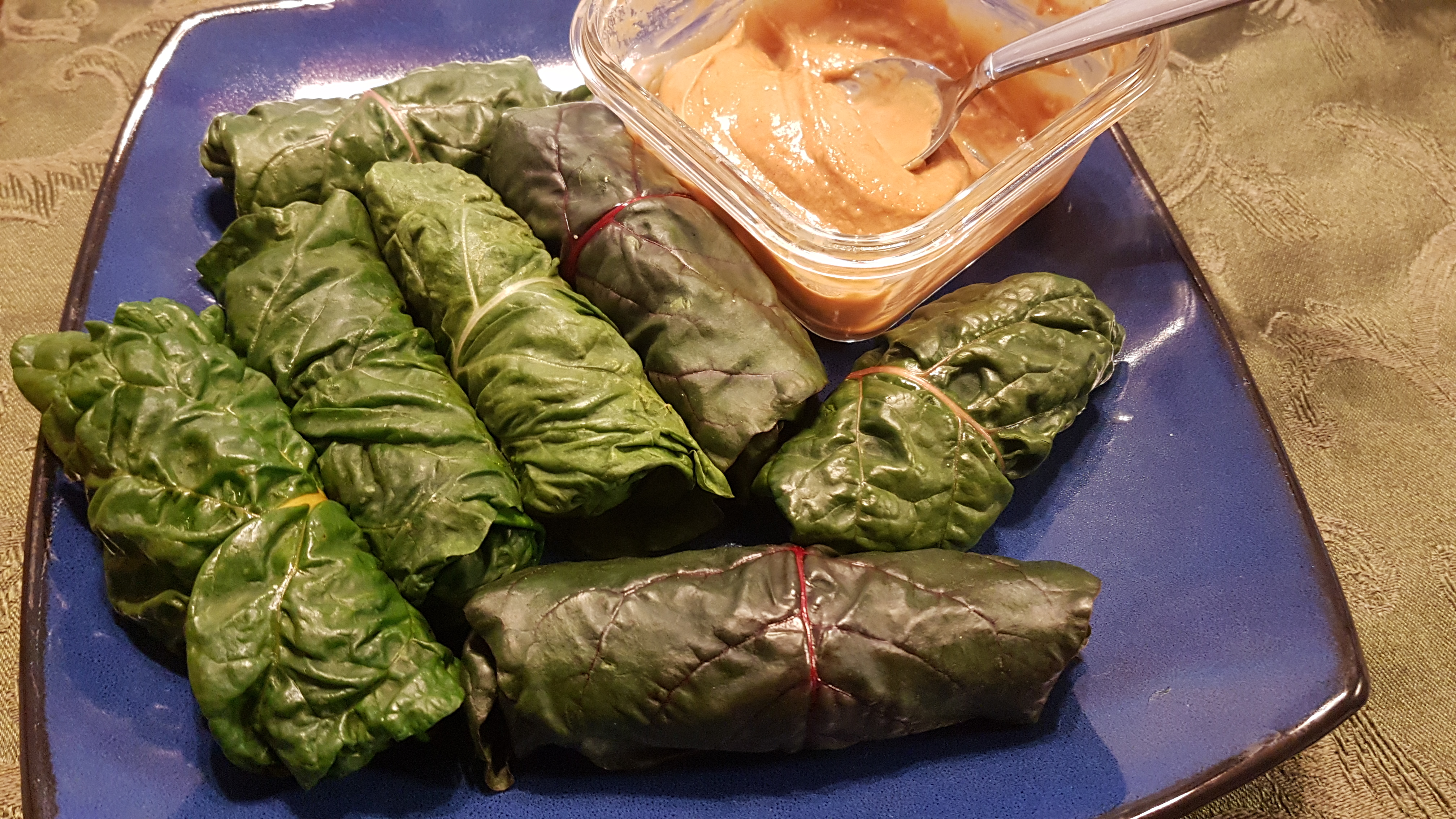 Swiss chard spring rolls with peanut sauce