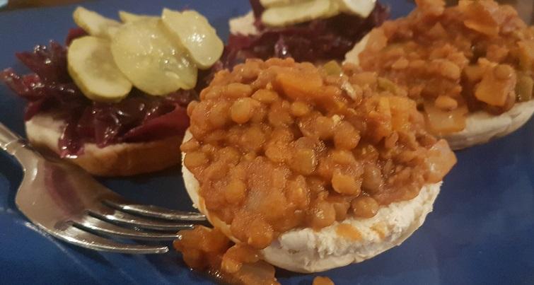 sloppy joe with lentils pickles and sauerkraut
